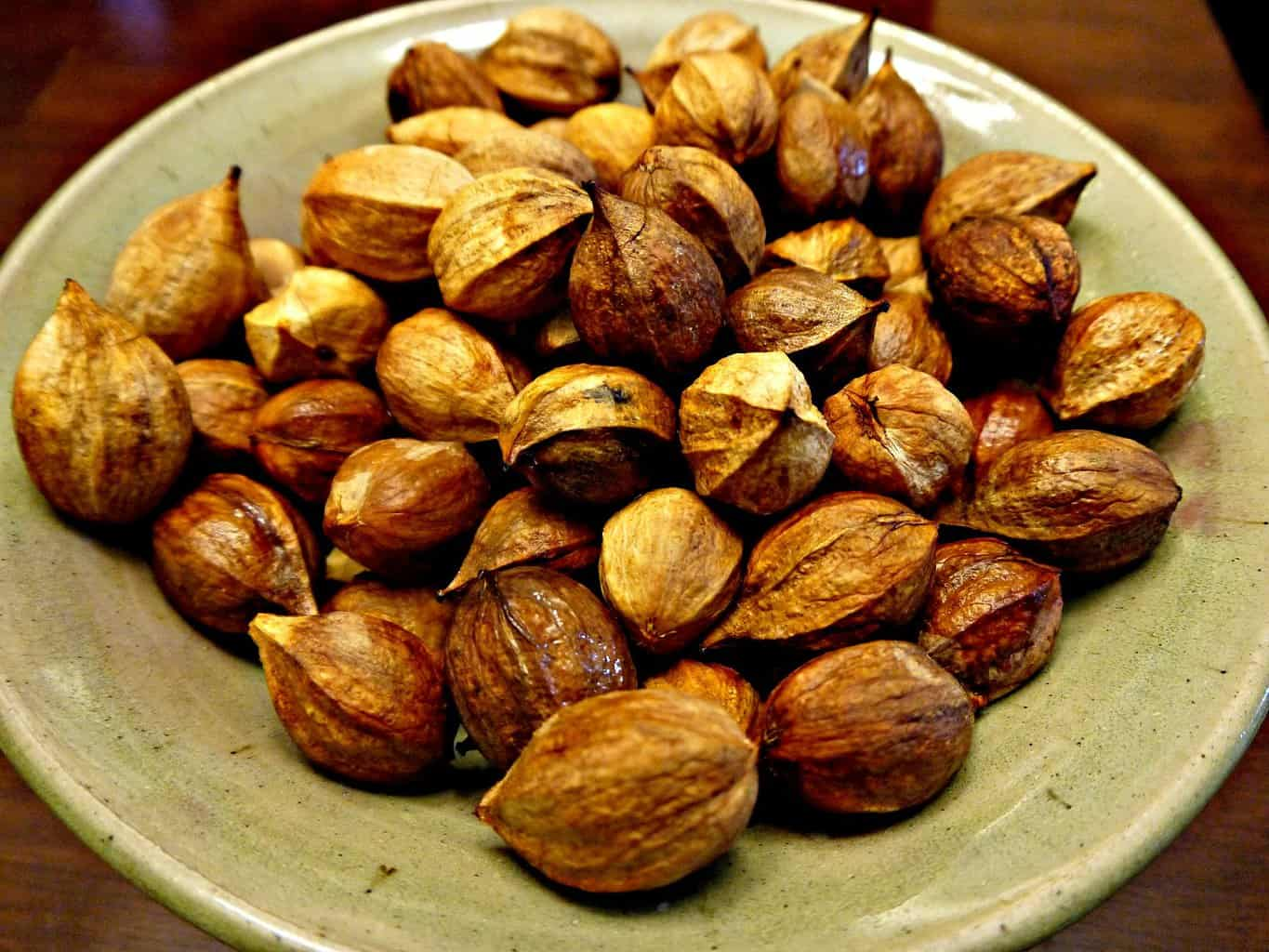 From recipe hickory nut ambrosia: picture of hickory nuts de-husked in bowl