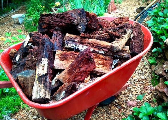 Old logs aren't waste - they're a great base for a hugelkultur bed, a permaculture method for making incredibly rich, long-lasting soil teeming with life.