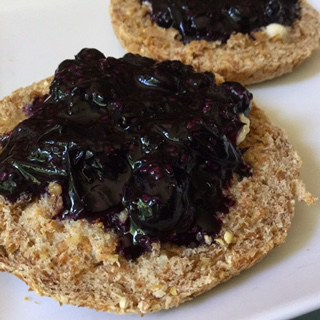 Yum! Garden hucklberry preserves on whole grain English muffin with local grass-fed butter.